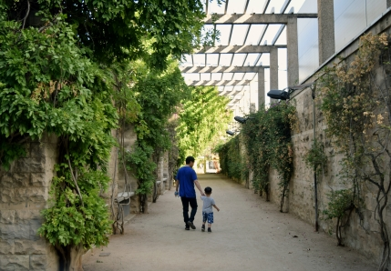 Father & son on a stroll through Parc de Joan Miro; Barcelona, Spain