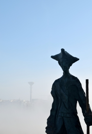 Soldier standing above the fog; A Coruna, Spain